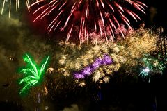 Colorful fireworks over a night sky Stock Photos