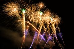 Colorful fireworks over night sky Stock Images