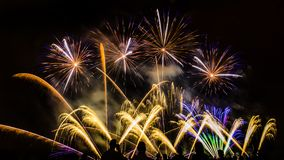 Colorful fireworks over night sky Stock Photos