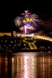 Colorful Fireworks over river Royalty Free Stock Photography