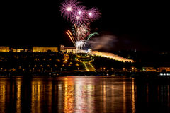 Colorful Fireworks over river Stock Photography