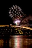 Colorful Fireworks over river Stock Photos