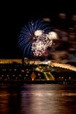 Colorful Fireworks over river Stock Images