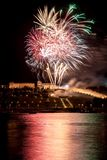 Colorful Fireworks over river Stock Image