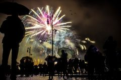 Fireworks colorful with crowd silhouette royalty free stock photography