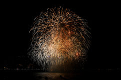 Colorful fireworks. Reflect from water Royalty Free Stock Image