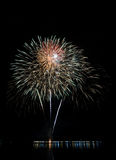 Colorful fireworks with reflection on lake Royalty Free Stock Images
