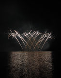 Colorful fireworks with reflection on lake. Royalty Free Stock Image