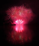 Colorful fireworks with reflection on lake. Stock Images