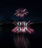 Colorful fireworks with reflection on lake. Colorful fireworks with reflection on lake and night sky in background royalty free stock photography
