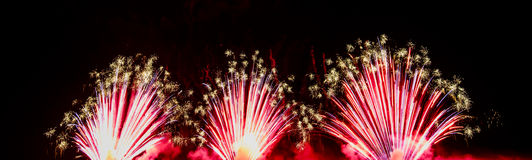 Colorful fireworks of various colors over night sky Royalty Free Stock Photo