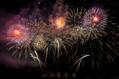 Colorful fireworks of various colors over night sky Royalty Free Stock Photography