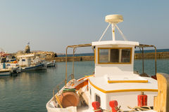 Colorful fish boat against the port of Naoussa at Paros island in Greece. Stock Images