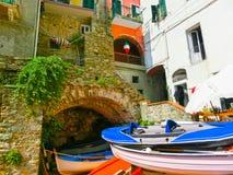 Colorful fish boats at Manarola, Cinque Terre, Italy Stock Photos