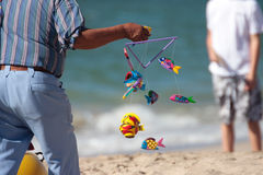 Colorful fish mobile on beach. Merchant selling colorful fish mobile on beach of San Carlos, Mexico Stock Image
