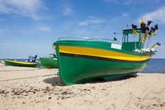 Colorful fisher boats on Baltic beach. Under blue skies Royalty Free Stock Photo