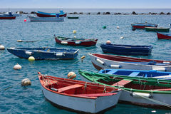 Colorful fisher boats in blue turquoise sea Royalty Free Stock Photography