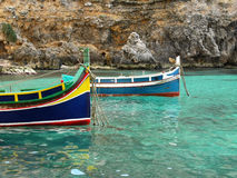 Colorful fisherman's boat called. Colorful fisherman's eyed boat called Iuzzu tipical of Malta anchored in a crystal clear water Royalty Free Stock Photo