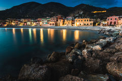 Colorful fisherman`s houses on the sand beach lagoon on italian Riviera in Varigotti, Savona, Liguria, Italy. Areal view of small town varigotti with its beach Stock Image