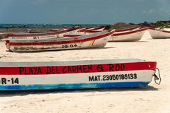 Colorful fishermen boats on Playa Tulum. stock image