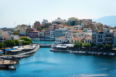 Colorful fishermen village. View on old town Agios Nikolaos sea port on sunny day. View from the observation deck. Colorful fishermen village. View on old town Royalty Free Stock Photo