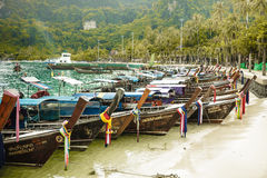Colorful fishermens boats on the beach in Thailand province Royalty Free Stock Image