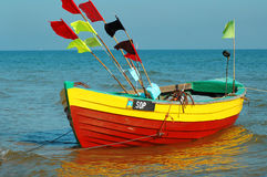 Colorful fishing boat. With flags floating on the water Royalty Free Stock Images