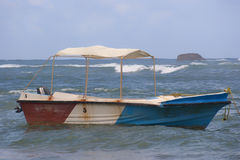 Colorful fishing boat. In blue sea off coast of Sri Lanka royalty free stock photos