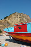 Colorful fishing boat on dry land Stock Photo