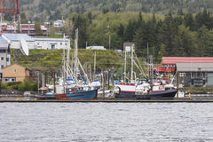Colorful Fishing Boats in Alaska Harbor Stock Images