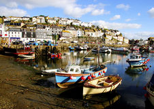 Colorful fishing boats at anchor in  Mevagissey. Colorful fishing boats at anchor at low tide  in  Mevagissey fishing village, Cornwall, England Royalty Free Stock Photos