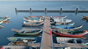 Colorful fishing boats docked in marina or port stock video