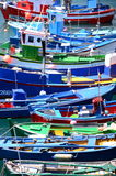 Colorful fishing boats in fishing harbor in Las Galletas on Tenerife. Royalty Free Stock Photos
