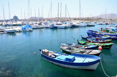 Colorful fishing boats in fishing harbor in Las Galletas on Tenerife. Royalty Free Stock Images