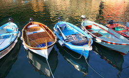 Colorful fishing boats floating in the Vernazza harbor in the Cinque Terre Royalty Free Stock Photos