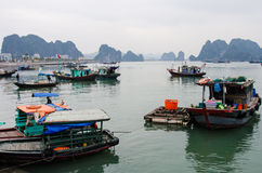 Colorful fishing boats in Halong Bay, Vietnam Stock Photo