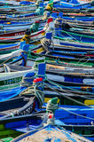 Colorful fishing boats. Ligned up, colorful fishing boats in Portugal, Setubal. Sunny Summer day Royalty Free Stock Images