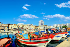Colorful fishing boats in old port Bizerte. Tunisia, North Afric. Scenic view of colorful fishing boats in Bizerte. Tunisia, North Africa Stock Photos