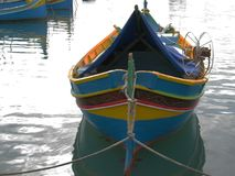 Colorful fishing boats in the port. Malta. Marsaxlokk. Malta. Marsaxlokk. There are many fishing boats in the harbor. The color of the boats is typical for this Stock Image