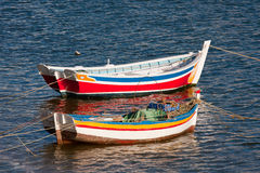 Colorful fishing boats in Portugal. Stock Photos