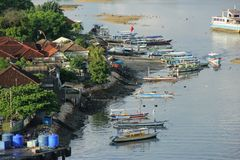 Fishing Boats. Colorful Fishing Boats pulled up onto the beach near the town of Benoa on the island of Bali, Indonesia stock photo