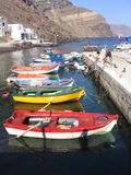 Colorful fishing boats, Santorini, Greece. Colorful fishing boats, and fishermen preparing their gear, Santorini, Greece Stock Image