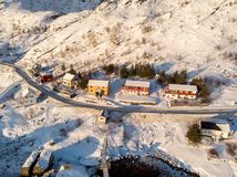 Colorful fishing house on coastline in snowfall on winter. Aerial view of Colorful fishing house on coastline in snowfall on winter royalty free stock image