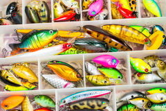 Colorful fishing lures and accessories in the box Royalty Free Stock Photos