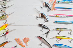 Colorful Fishing Lures on wood desk Stock Photo