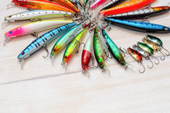 Colorful Fishing Lures on wood desk Stock Images
