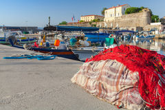 Colorful fishing net laying in port of Ajaccio Stock Photos