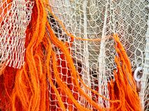 Fishing nets are drying on the quay. Colorful fishing nets are drying on the quay in the harbor next to the fish auction royalty free stock photo