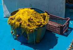 Colorful fishing nets and floats in basket after fishing. Stock Photos
