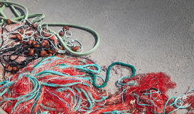 Colorful fishing nets lay on concrete pier Royalty Free Stock Image